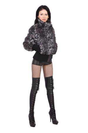 The young beautiful girl in a fur coat  isolated on white Stock Photo - 11003823