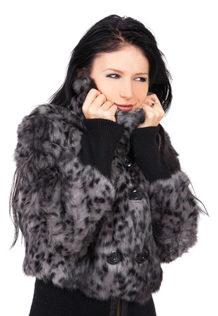 The young beautiful girl in a fur coat  isolated on white Stock Photo - 11004003