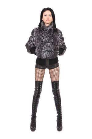 The young beautiful girl in a fur coat  isolated on white Stock Photo - 11003824