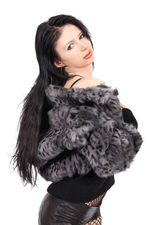 The young beautiful girl in a fur coat  isolated on white photo