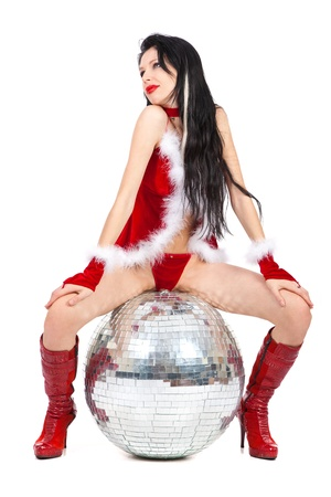 Sexy santa helper with big disco ball isolated on white background photo