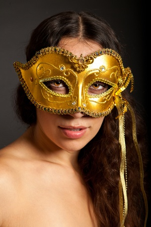 Photo of a young woman wearing mask isolated on a white background photo