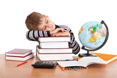 Tired schoolboy isolated on a white background Stock Photo - 11071694