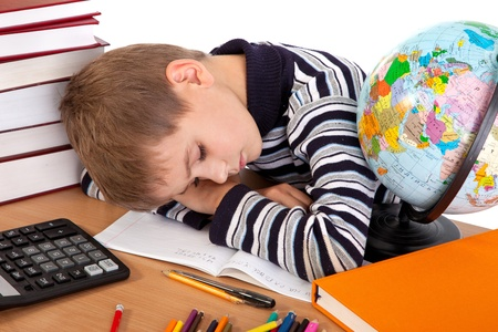 Tired schoolboy isolated on a white background Stock Photo - 11071672