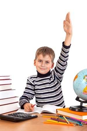Cheerful Schoolboy ready to answer question isolated on a white background photo