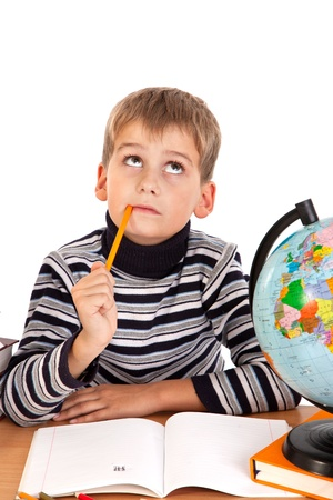 Cute schoolboy is thinking isolated on a white background Stock Photo - 11071731