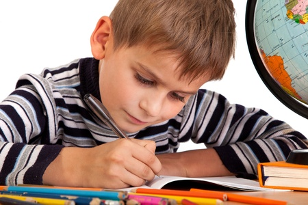 kids writing: Cute schoolboy is writting isolated on a white background Stock Photo