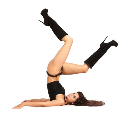 hot girl legs: Sexy woman practicing yoga. Wears beautiful boots isolated on a white background