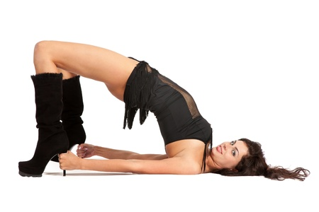 hot girl lying: Sexy woman practicing yoga. Wears beautiful boots isolated on a white background