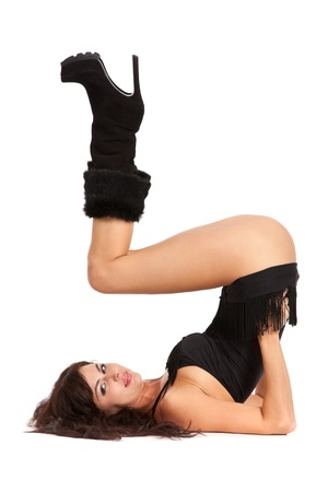 Sexy woman practicing yoga. Wears beautiful bootsisolated on a white background photo
