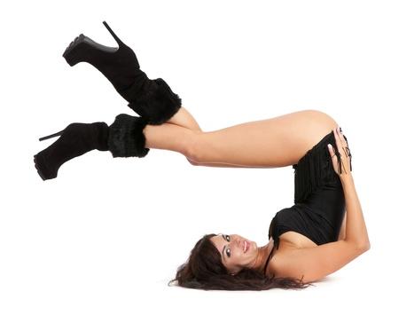 boast: Donna sexy yoga. Indossa stivali bella isolato su uno sfondo bianco