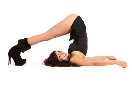 Sexy woman practicing yoga. Wears beautiful boots isolated on a white background Stock Photo - 11071620
