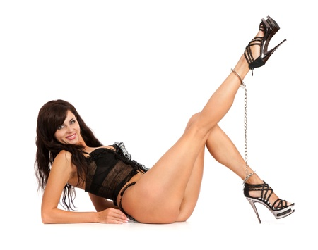 Sexy woman. Legs in chains - isolated on white Stock Photo - 11071626