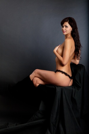 Sexy nude woman isolated in a black background Stock Photo - 11071663