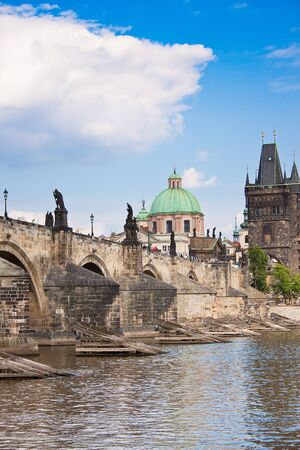 Karlov or charles bridge in Prague in winter photo