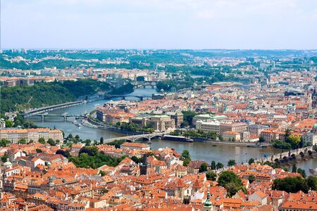 Cityscape of Prague in summer. River, bridges photo