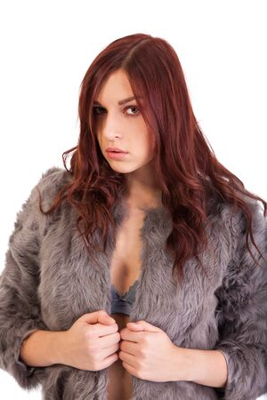 nice breast: The young beautiful girl in a fur coat  isolated on white