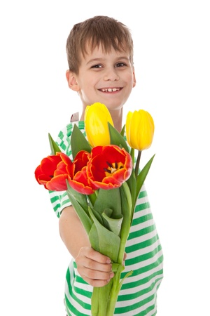 Young boy holding tulips isolated on white photo