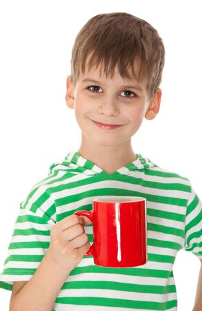 Boy holding a red cup isolated on white photo
