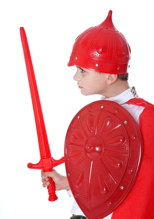 Young Boy Dressed Like a knight holding a sword and shield isolated on white Stock Photo - 11318316