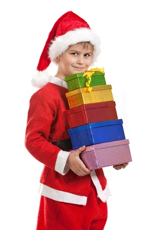 klaus: Boy holding a christmas gift isolated on white background Stock Photo