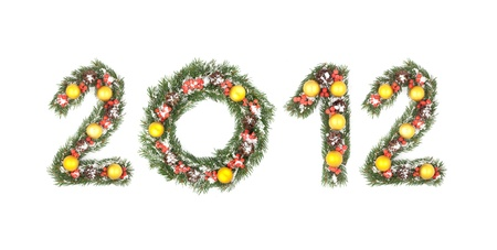 2012 number written by christmas tree branches isolated on a white background photo