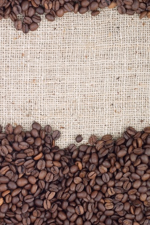Brown roasted coffee beans. Shot in a studio photo