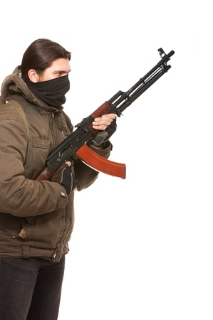 Terrorist with weapon on a white background photo