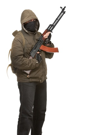 one armed: Terrorist with weapon on a white background Stock Photo