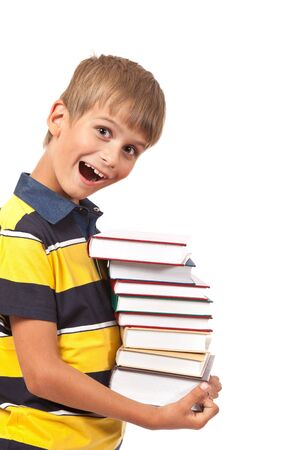 School boy is holding books isolated on white background photo