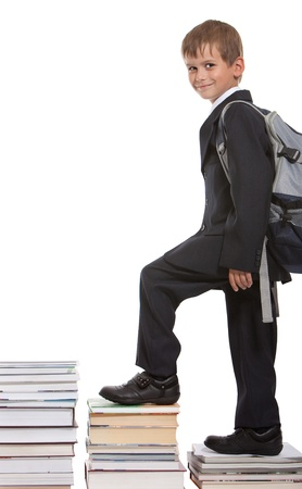 steps to success: Education success graph - successful schoolboy isolated on white background
