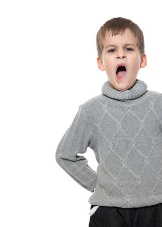 Cute boy yawning isolated on a white background photo