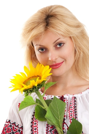 Woman wears Ukrainian national dress is holding a sunflower photo