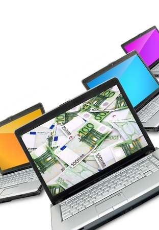 Open laptops with money  isolated on white background Stock Photo - 13060129