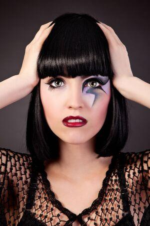 Beautiful fantasy eye face-art close-up portrait of a beautiful girl photo