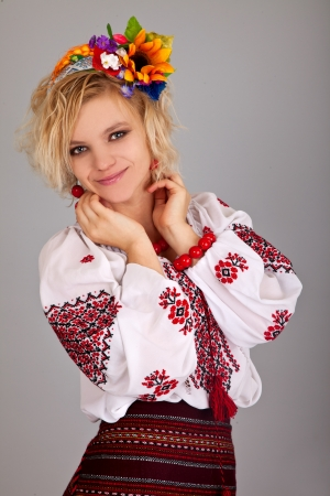 national cultures: Attractive woman wears Ukrainian national dress isolated on a white background