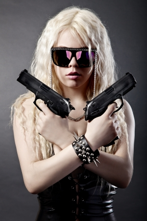 Beautiful sexy girl with guns isolated on black background photo