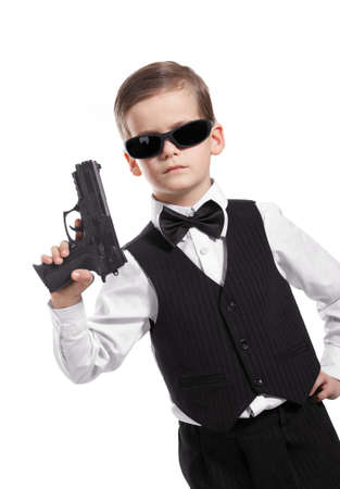 Boy with a weapon on a white background photo