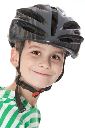 Boy bicyclist with helmet isolated on white photo