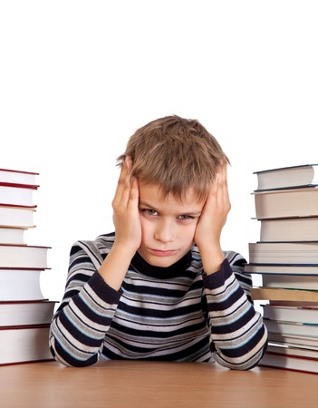 bored student: Tired schoolboy isolated on a white background Stock Photo