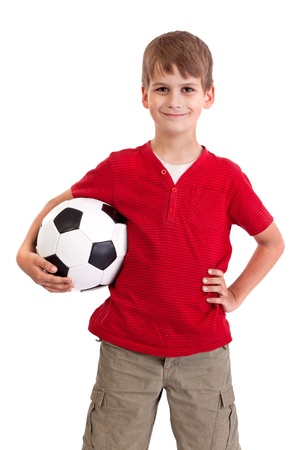 Cute boy is holding a football ball made of genuine leather  isolated on a white background. Soccer ball photo
