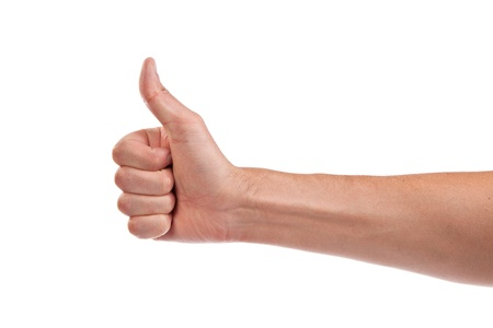 Closeup of male hand showing thumbs up sign isolated against white background photo