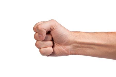 pu�os cerrados: La mano con el pu�o cerrado una, aisladas sobre un fondo blanco Foto de archivo