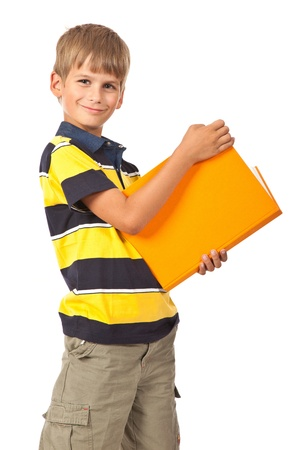 School boy is holding a book isolated on white background photo