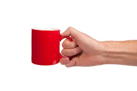 Male hand is holding a red cup isolated on a white background Stock Photo - 14577062
