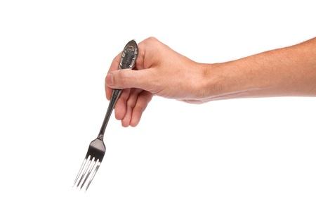 Pravá Mans ruce s prázdnou kovovou vidličkou na bílém pozadí