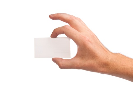 Businessmans hand holding blank paper business card, closeup isolated on white background photo