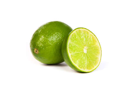 One whole lime and one half lime isolated on a white background photo