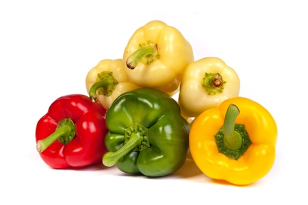 Group of seet bell peppers isolated on plain white background. photo