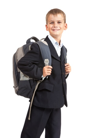 going: Schoolboy sitting on books isolated on a white background. Back to school